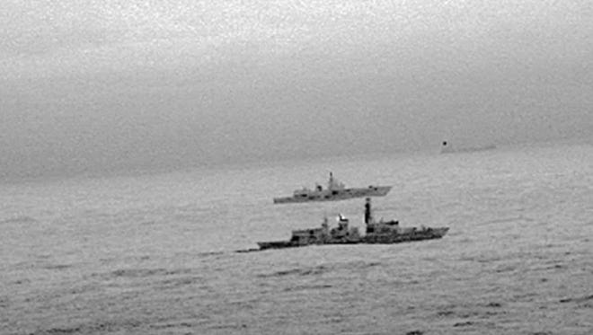 A handout photo made available by the British Ministry of Defence (MOD) on Dec. 26 shows Britain's Royal Navy frigate HMS St Albans escorting a Russian warship through the North Sea and areas of British interest on Christmas Day.