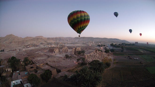 This file photo taken on Nov. 15, 2007, shows tourist hot air balloons floating during dawn across Egypt's Valley of the Kings, near Luxor.