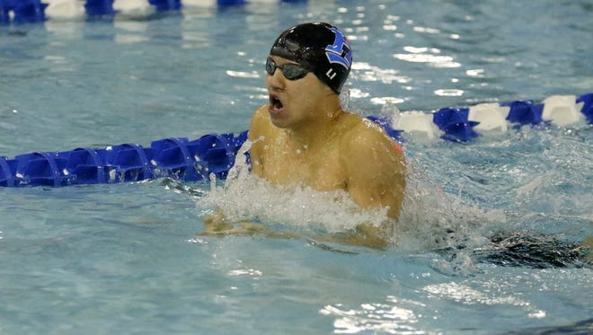Shoonhsin Li of Horseheads swims to a victory in the 200-yard individual medley Jan. 9 against Corning at Horseheads High School.