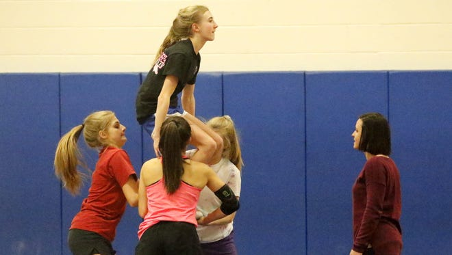 Horseheads coach Amy Buchanan works with some of her cheerleaders at practice Jan. 31 at Horseheads High School.