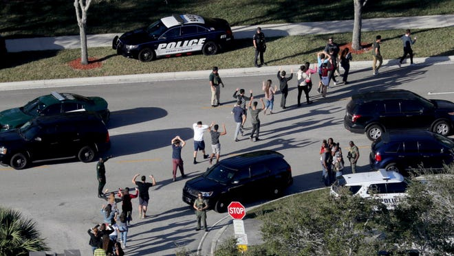 Students evacuate in Parkland, Fla., on Feb. 14, 2018.