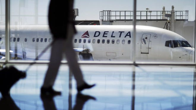 A Delta Air Lines jet sits at a gate at Hartsfield-Jackson Atlanta International Airport in Atlanta. Ga., on Oct. 13, 2016.