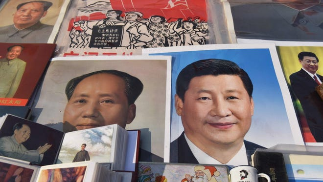 Posters of Chinese President Xi Jinping, right, and the late Mao Zedong in Beijing.