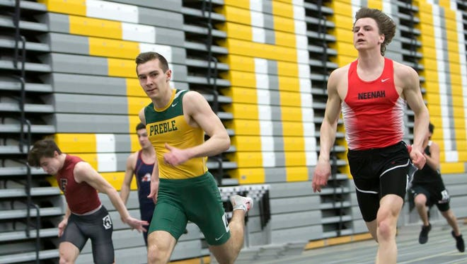 Green Bay Preble's Gavin Buergi competes in the 3,200-meter run March 13 during the Oshkosh High School Invitational at the Kolf Sports Center.