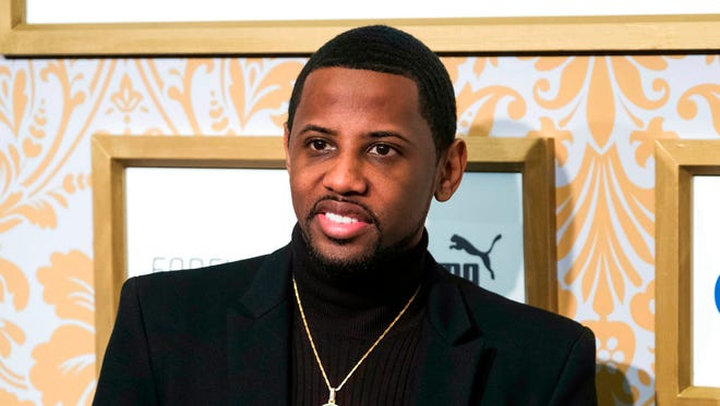 In this Jan. 27, 2018 file photo, Fabolous attends the Roc Nation pre-Grammy brunch at One World Trade Center in New York. Englewood police say the rapper, whose real name is John Jackson, turned himself in Wednesday, March 28. They say the alleged incident occurred earlier that day, but they would not identify the victim or say who reported it. He was charged with aggravated assault and making terroristic threats. He was released Wednesday night.
