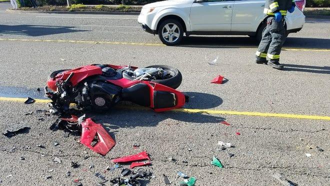 A Honda motorcycle driven by Mitchell Vandoren, of Milwaukie, struck a stalled car Sunday evening on Highway 212.