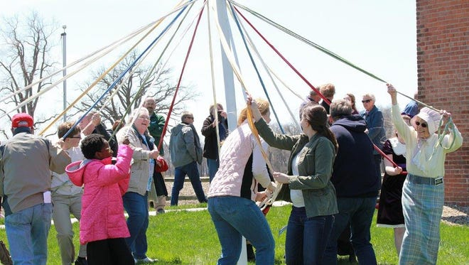 There was a wide variety of participants who shared in the Maypole dance Sunday afternoon, just outside Harvey One-Room School. Youngsters and some older folks behaved bravely taking on a few moments of warm up before weaving strands of white fabric with colored ones, 16 in all.