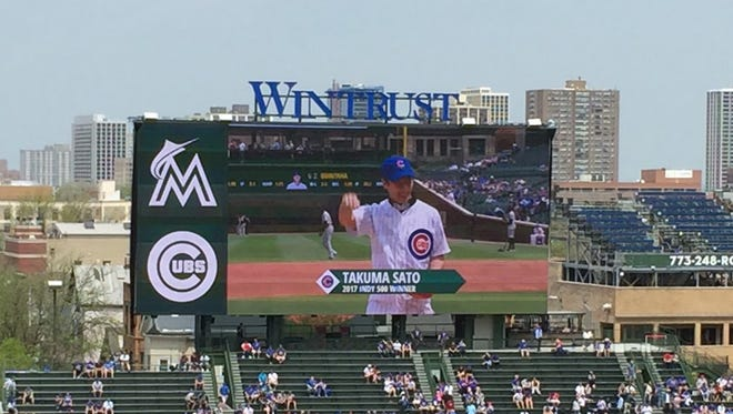 Takuma Sato threw out the first pitch at Wrigley Field before the Cubs took on the Marlins on May 9, 2018.