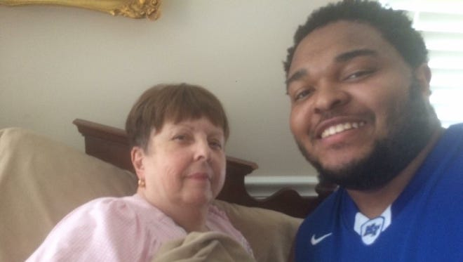 MTSU superfan Denzell Bowers with his mother, Joan Rene Farris Bowers, in April 2017.