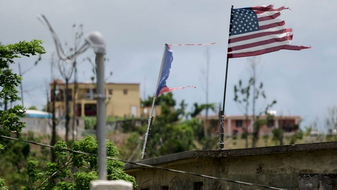 Deteriorated U.S. and Puerto Rico flags near Yabucoa on May 16, 2018.