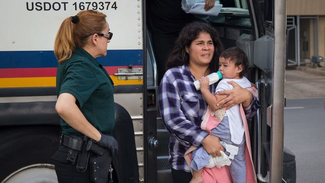 Immigrant woman and baby in McAllen, Texas, on June 17, 2018.