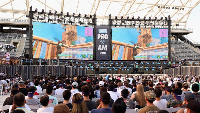Game enthusiasts and industry personnel attend the Epic Games Fortnite E3 Tournament.