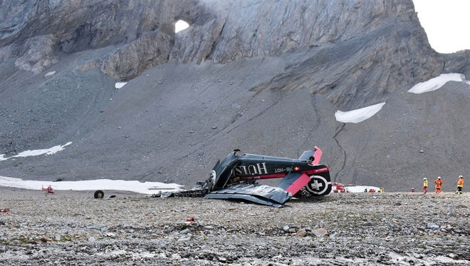 A handout photo made available by Cantonal Police of Grisons shows a wreckege of Junkers JU-52 aircraft after crashing on Piz Segnas above Flims, Switzerland, 5 August 2018. According to reports A Junkers JU-52 aircraft of the JU-AIR crashed on 04 August 2018 at Piz Segnas above Flims, Switzerland, on its way from Locarno to Duebendorf for unknown reasons. Authorities say all 20 people on-board died.