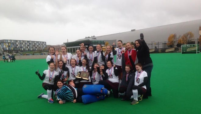 North Country field hockey poses with the state championship trophy on Saturday.
