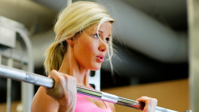 Chelsea Lawson works out at Anytime Fitness in Norwalk in this file photo.