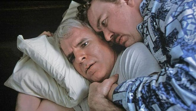 "Steve Martin and John Candy play mismatched traveling partners in the classic '80s comedy ""Planes, Trains and Automobiles."""