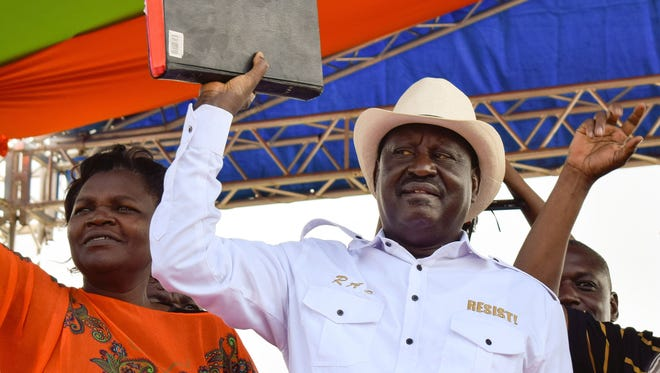 Kenyan opposition party National Super Alliance (NASA) leader, Raila Odinga holds a bible during a rally in Homa Bay on the shores of Lake Victoria, on January 27, 2018.  Kenyan opposition leader Raila Odinga was holding a rally on January 27, days before he plans to swear himself in as president of Kenya three months after losing an election to President Uhuru Kenyatta which he says was rigged. / AFP PHOTO / BRIAN ONGOROBRIAN ONGORO/AFP/Getty Images ORIG FILE ID: AFP_Y18EY