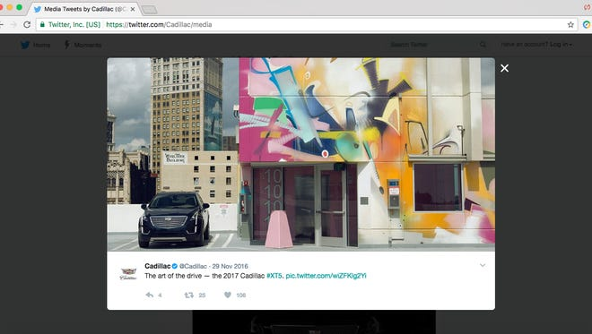 A Swiss artist is suing General Motors over the company's use of a photo showing his artwork in Detroit.