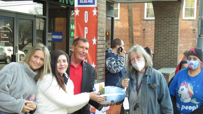 Colleen Donohue, Erin Minkoff and Paul Hamilton of Orange West Realty distribute Thanksgiving  turkeys.