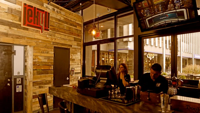 Jekell, the new bar and restaurant on Fountain Square, features rustic industrial touches. Jekyll sits in the former Mynt Martini location.