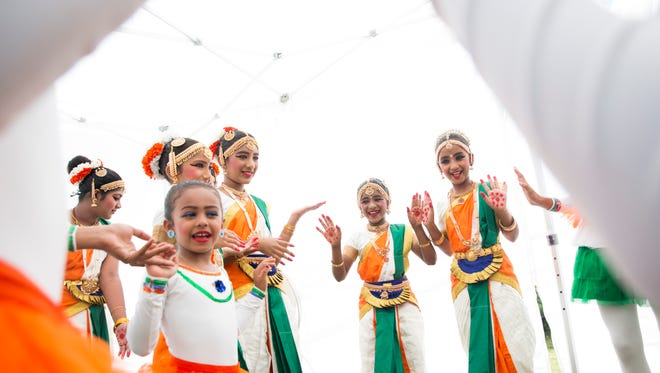 "Student dancers prepare backstage for their ""Ballet meets Bharatnatyam Dance"" performance during IndiaFest at Fleischmann Park on Saturday, March 25, 2017, in Naples."