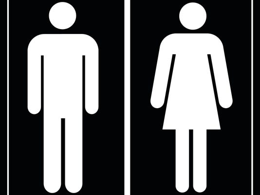 Toilet sign man and lady