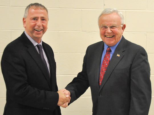 St. Cloud Mayor Dave Kleis, left, shakes the hand of Litchfield Mayor Keith Johnson  at the induction ceremony for Litchfield High School Hall of Fame on Friday at Litchfield High School.