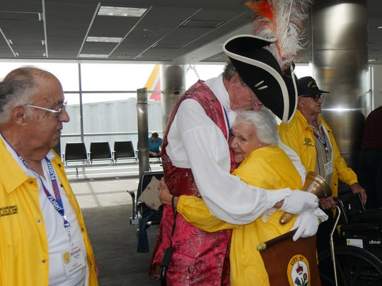 Veteran Tina Benito receives a hug during an Honor Flight of Southern New Mexico trip to Washington, D.C.