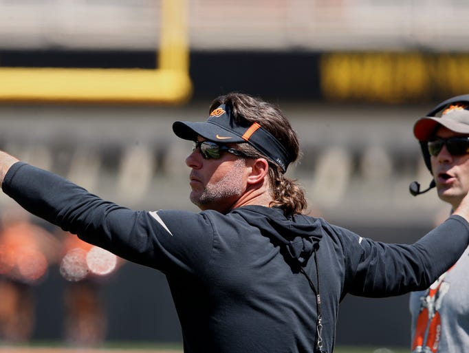 Oklahoma State head coach Mike Gundy gestures to his
