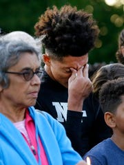 De'Juan Johnson, 15, a friend of Jordan Edwards becomes emotional as he listens to speakers at a candle light vigil for Edwards in Balch Springs, Texas, Thursday, May 4, 2017.  (AP Photo/Tony Gutierrez)