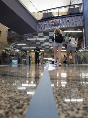 Blue tape and red taped directional arrows on the floor direct people through the Student Union Building to help direct foot traffic through the building on the Texas Tech University campus on the first day of the Fall 2020 semester on Monday, Aug. 24, 2020, in Lubbock, Texas.