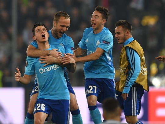 Marseille players celebrate after scoring against FC