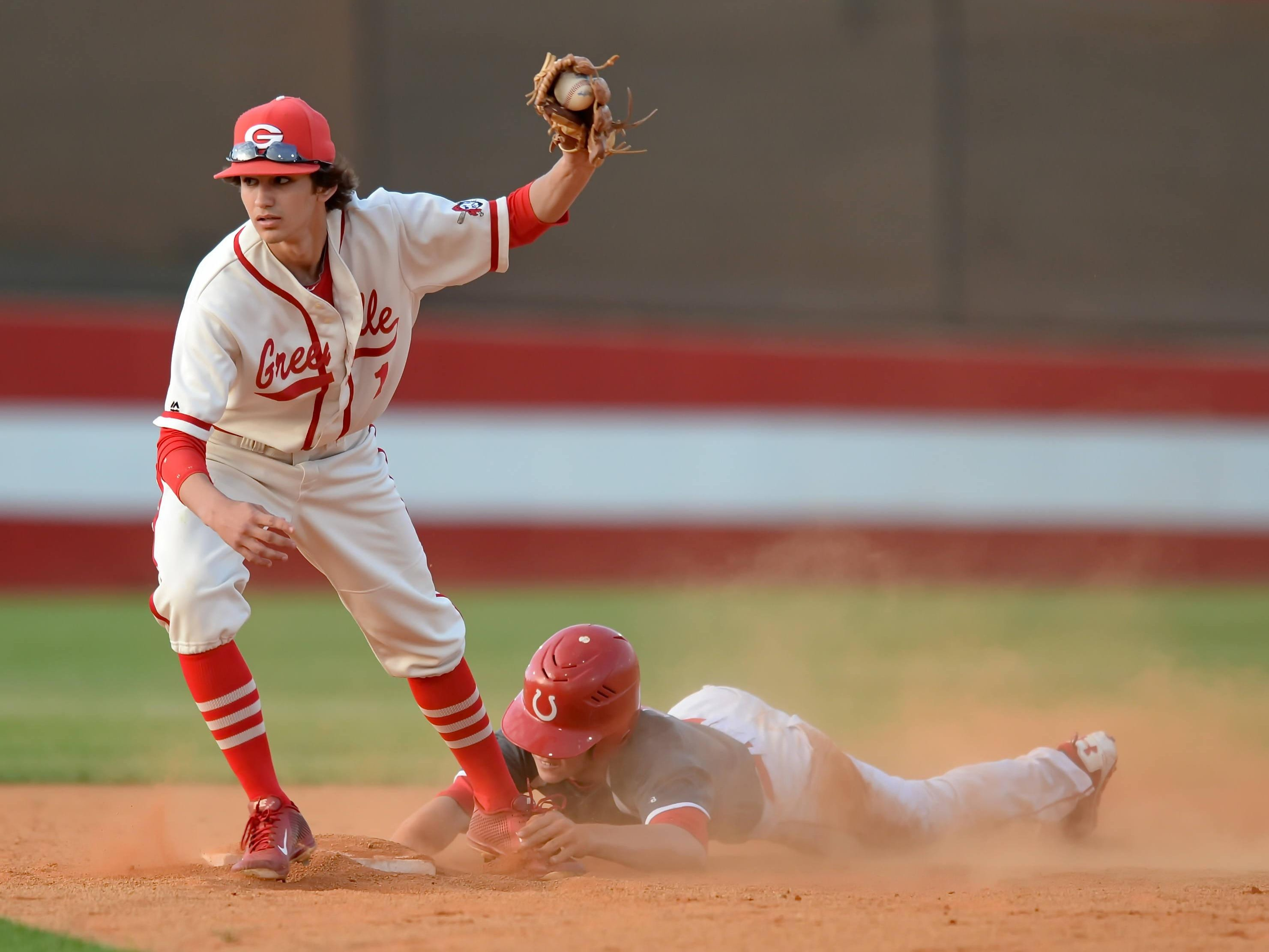 Greenville shortstop Grant Cox, left, has been selected to the American Family Insurance All-USA state team.