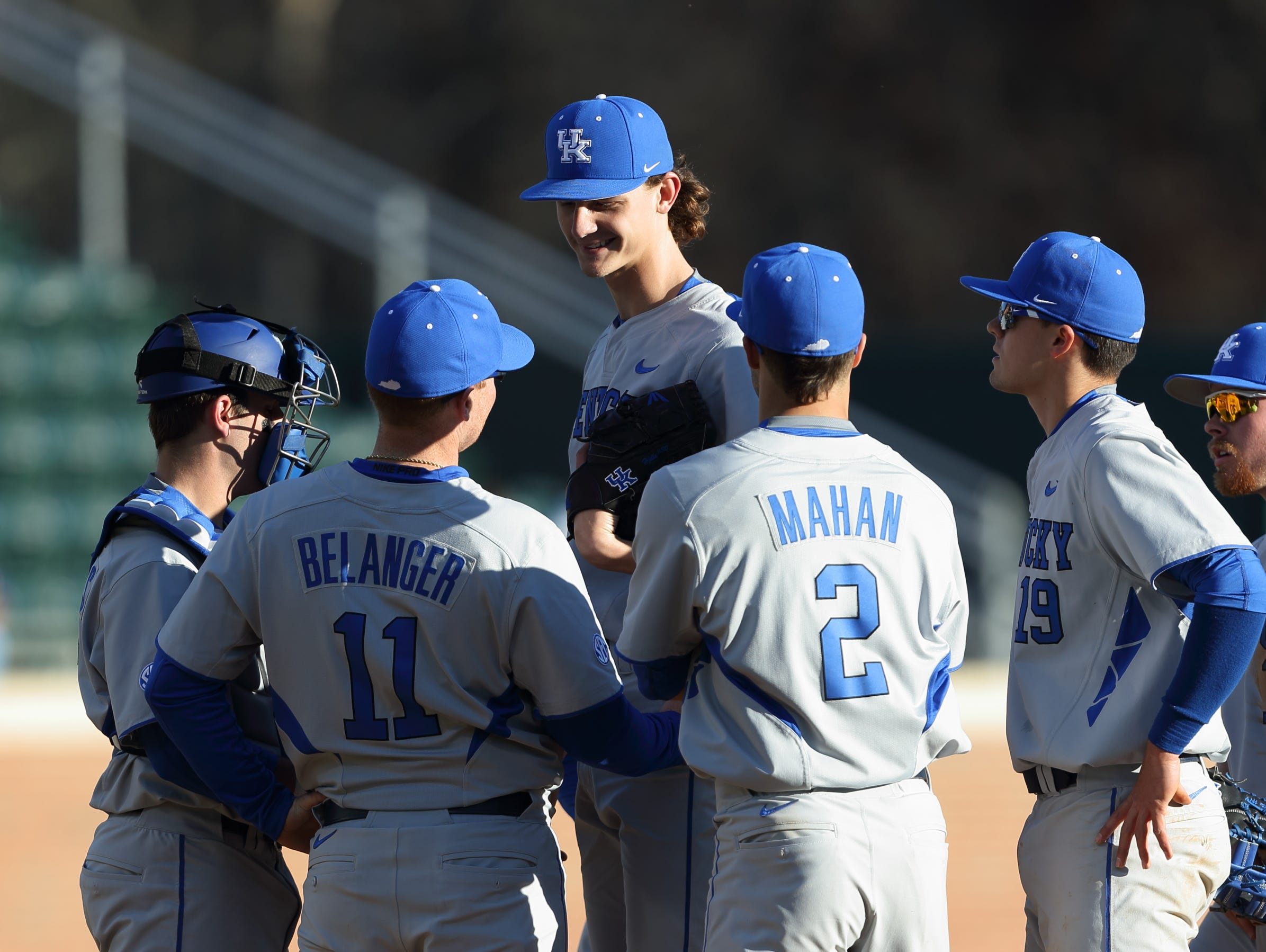 UK pitching coach Jim Belanger meets with starter Sean Hjelle and the Wildcats infield during a mound visit.