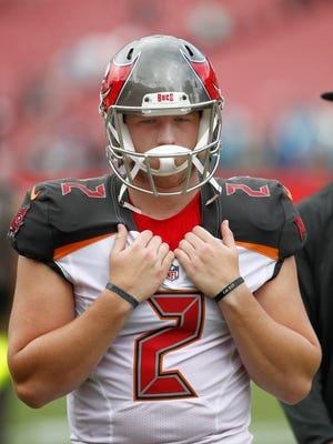 Tampa Bay Buccaneers kicker Kyle Brindza walks off of the field after a game against the Carolina Panthers at Raymond James Stadium.