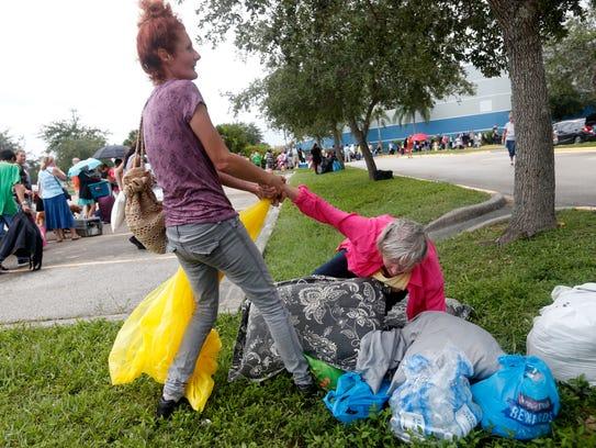 Heather Turner helps up her mother Jean Turner, 79,