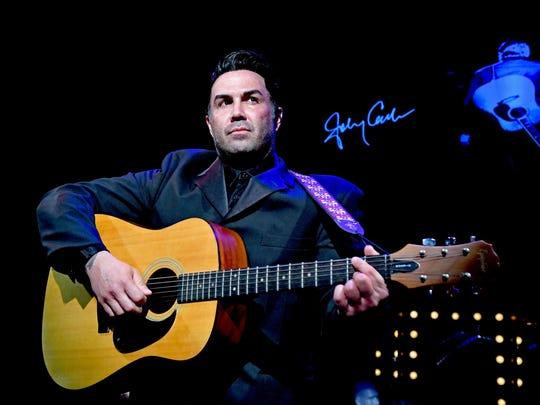 Alfie Silva performs as Johnny Cash. The MCT Christmas