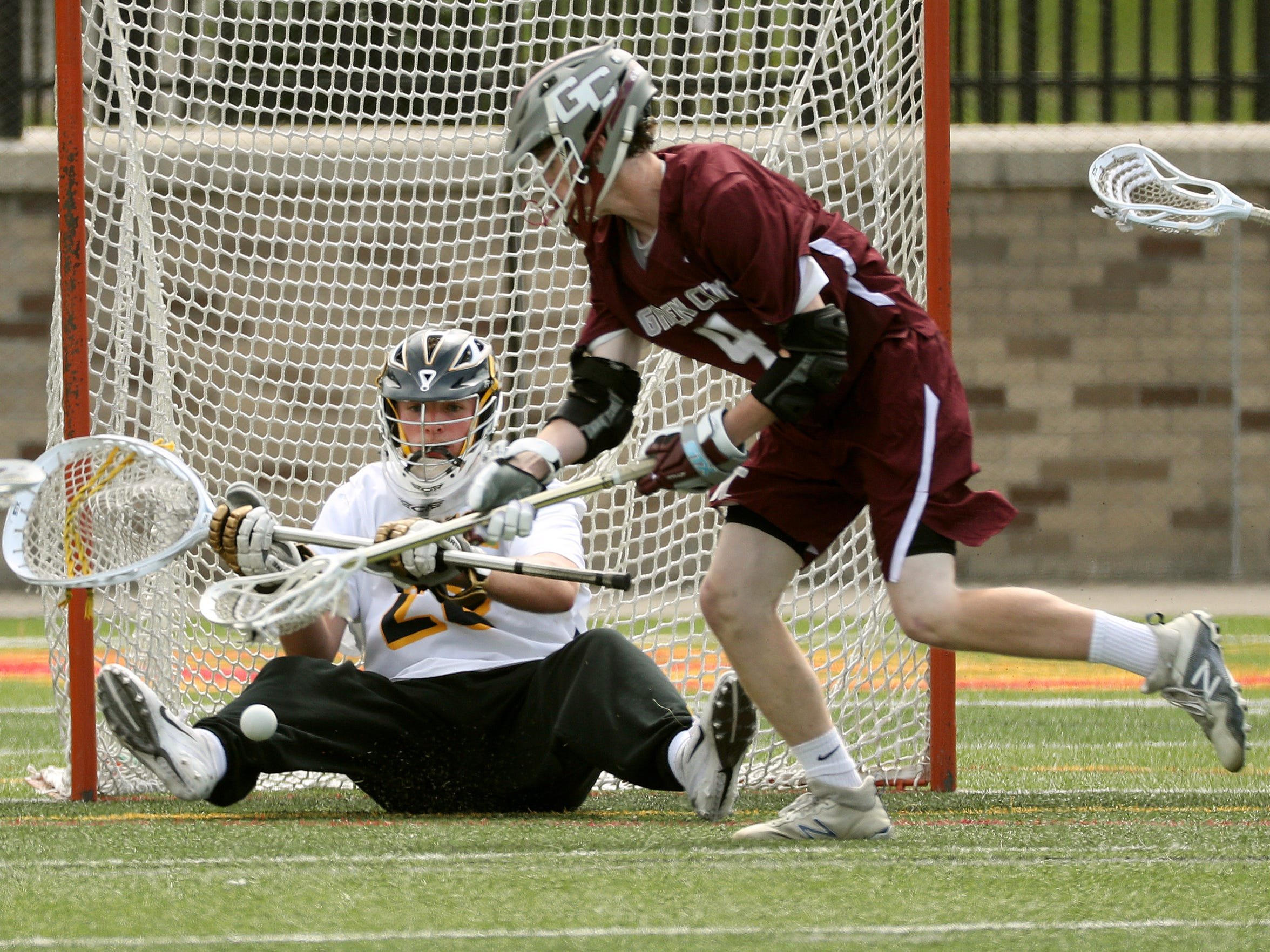 Victor goalie Chayse Ierlan makes this stop on a shot by Garden City's Liam Curtin (4) in the Class B state final.