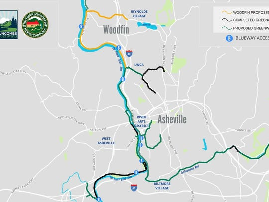 The gold line represents the proposed Woodfin greenway project.