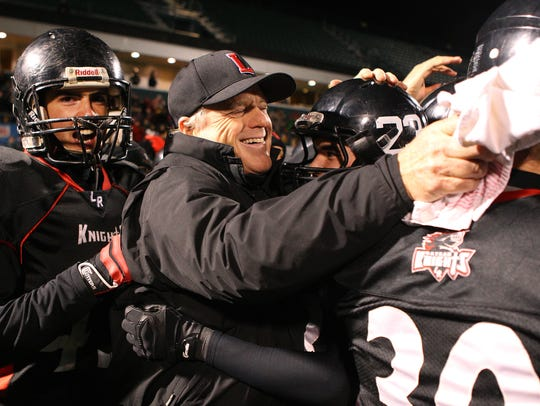 LeRoy head coach Brian Moran congratulates his players