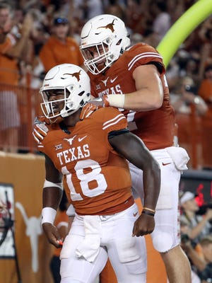 Texas Longhorns quarterback Tyrone Swoopes (18) reacts after scoring a touchdown in overtime against the Notre Dame Fighting Irish at Darrell K Royal-Texas Memorial Stadium.