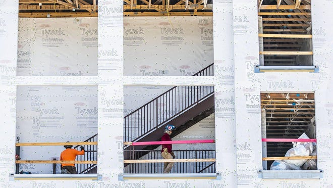 Construction crews work last week at an apartment project in Kyle. While rents and occupancy rates declined across most of Central Texas in the second quarter, the Kyle and Buda area saw occupancy rate hold steady and rents rise slightly.