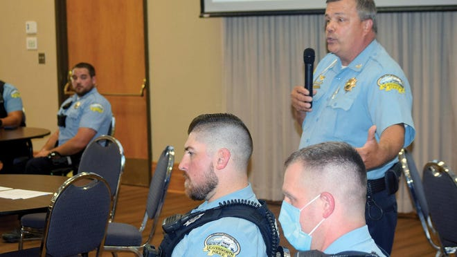 Leavenworth Police Chief Pat Kitchens, right, speaks Monday during a forum focusing on the use of force by police officers. The event was attended by other members of the Leavenworth Police Department.