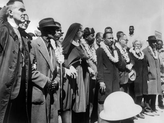 Civil rights demonstrators, led by Dr Ma