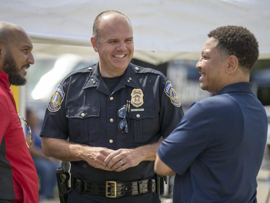 IMPD Chief Troy Riggs, chats with Rev. Donald Edwards,