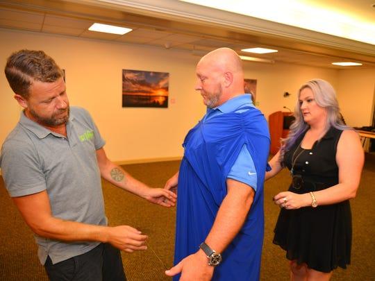 Susan Naylor and LG Donovan help Dr. Joseph Slattery