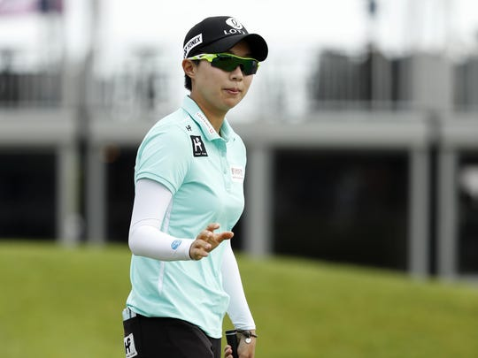 Hyo Joo Kim, of South Korea, reacts after making a birdie putt on the ninth green during the first round of the KPMG Women's PGA Championship Thursday in Chaska, Minn.