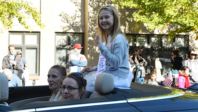 """Savannah Kennedy, 9, Lebanon, rides in the Lebanon Holiday Parade Saturday, November 19, 2016 with her mom, Christina Wenrich, left, and friend, Laura Boltz. Riding in the parade was the prelude to her wish of a shopping spree in Hershey fulfilled by the Kids Wish Network. She has a lifelong diagnosis of refractory epilepsy. """"It made me feel happy because everyone clapping and having support,"""" said Kennedy. A Kids Wish Network spokesperson said the Community of Lebanon Association helped Kennedy get into the parade and the car was provided by Brownstone Real Estate."""