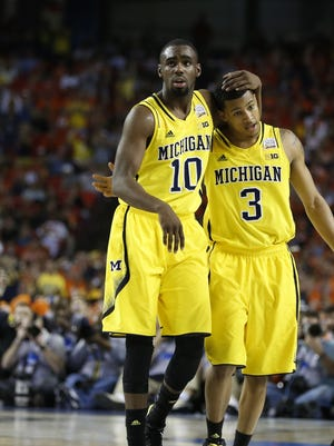 Michigan's Tim Hardaway Jr. and Trey Burke walk to the bench as Syracuse takes their final timeout in U-M's win to reach to the national championship game in 2013.