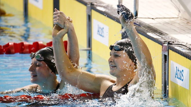Olympian Caitlin Leverenz, right, of Tucson won the 200 IM Saturday in a Pan American Games record.